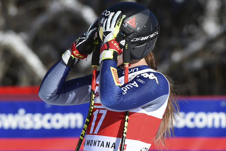 Italy's Sofia Goggia gets to the finish line after completing an alpine ski, women's World Cup super-G, in Crans Montana, Switzerland, Sunday, Jan. 24, 2021. (AP Photo/Marco Tacca)
