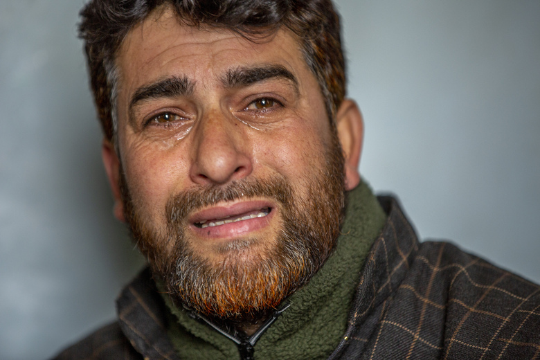 "Mushtaq Ahmad Wani, father of 16-year-old Athar Mushtaq, breaks down while talking to Associated Press in Bellow, south of Srinagar, Indian controlled Kashmir, Tuesday, Jan. 5, 2021. On the last week of 2020, Indian government forces killed Athar and two other young men during a controversial gunfight on the outskirts of the Indian-controlled Kashmir's main city. Police did not call them anti-India militants but ""hardcore associates of terrorists."" They later buried them at a graveyard in a remote mountainous tourist resort miles away from their ancestral villages. Athar was the latest Kashmiri to be buried in a far-off graveyard after Indian authorities in a new controversial policy in 2020 started to consign blood-soaked bodies of scores of Kashmiri suspected rebels to unmarked graves, denying the mourning families a proper funeral and a burial. (AP Photo/ Dar Yasin)"