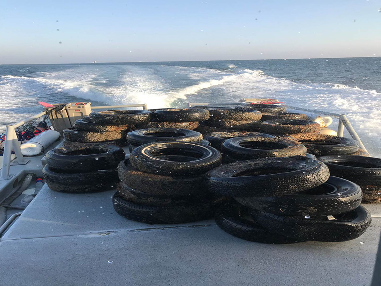 FILE – This Oct. 12, 2017, file photo provided by the California Coastal Commission/UC Davis shows a pile of scrap tires after they were pulled out of the water off Balboa Peninsula in Newport Beach, Calif. California may ask tire manufacturers to look at ways of eliminating zinc from their products because studies have shown the mineral may harm aquatic wildlife when it is washed into rivers and lakes. (California Coastal Commission/UC Davis via AP, File)