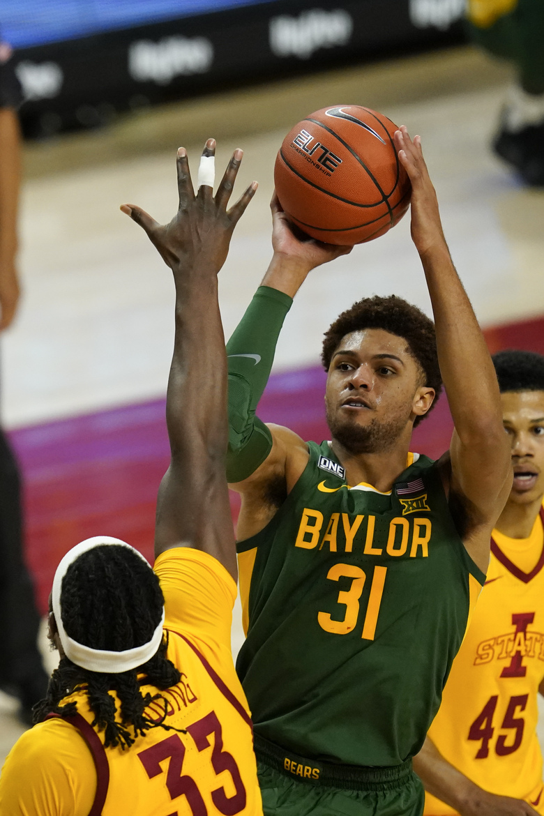 Baylor guard MaCio Teague (31) shoots over Iowa State forward Solomon Young (33) during the second half of an NCAA college basketball game, Saturday, Jan. 2, 2021, in Ames, Iowa. Baylor won 76-65. (AP Photo/Charlie Neibergall)