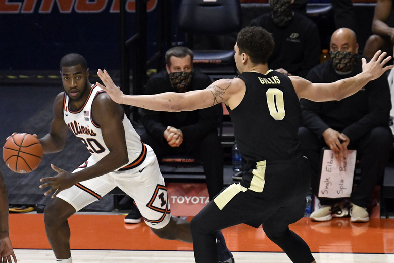 Illinois guard Da'Monte Williams (20) drives the ball as Purdue's forward Mason Gillis (0) defends in the first half of an NCAA college basketball game Saturday, Jan. 2, 2021, in Champaign, Ill. (AP Photo/Holly Hart)