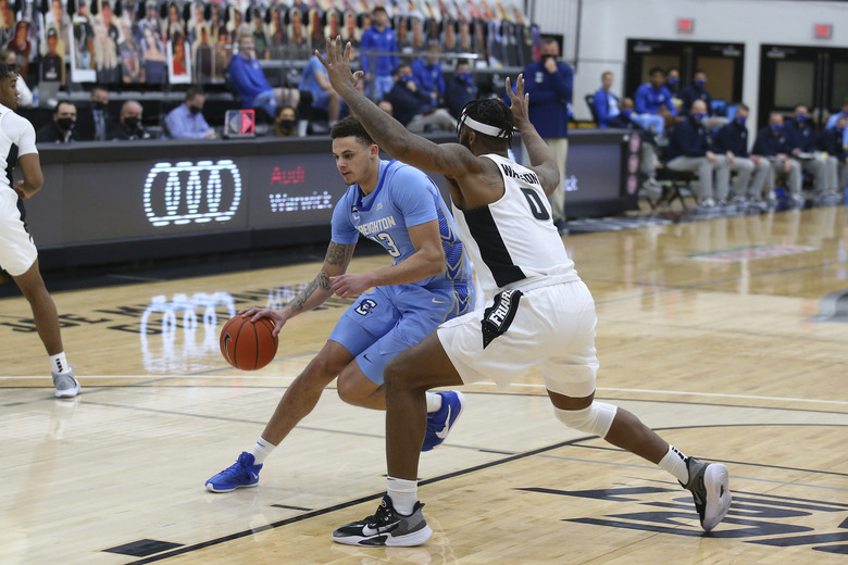 Creighton's Christian Bishop (13) drives to the basket as Providence's Nate Watson (0) defends during the first half of an NCAA college basketball game Saturday, Jan. 2, 2021, in Providence, R.I. (AP Photo/Stew Milne)