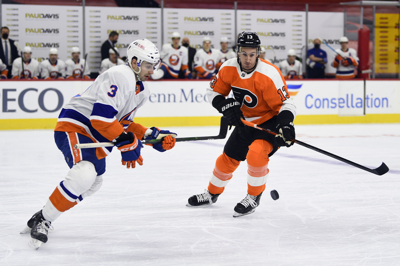 Philadelphia Flyers' Kevin Hayes, right, plays the puck against New York Islanders' Adam Pelech during the first period of an NHL hockey game Saturday, Jan. 30, 2021, in Philadelphia. (AP Photo/Derik Hamilton)