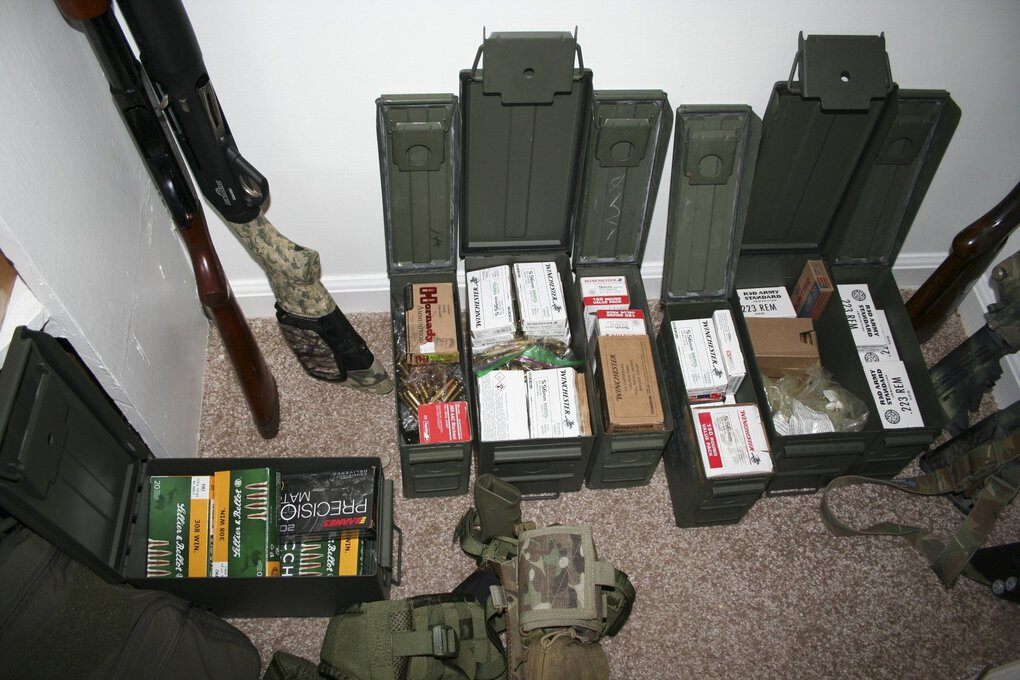 The firearms and ammunition found with W. McCall Calhoun at his sister's home in Macon, Ga., when he was taken into custody. Calhoun remains in federal custody, accused of participating in the pro-Trump mob that stormed the U.S. Capitol. (U.S. Attorney's Office, Middle District of Georgia via The New York Times)