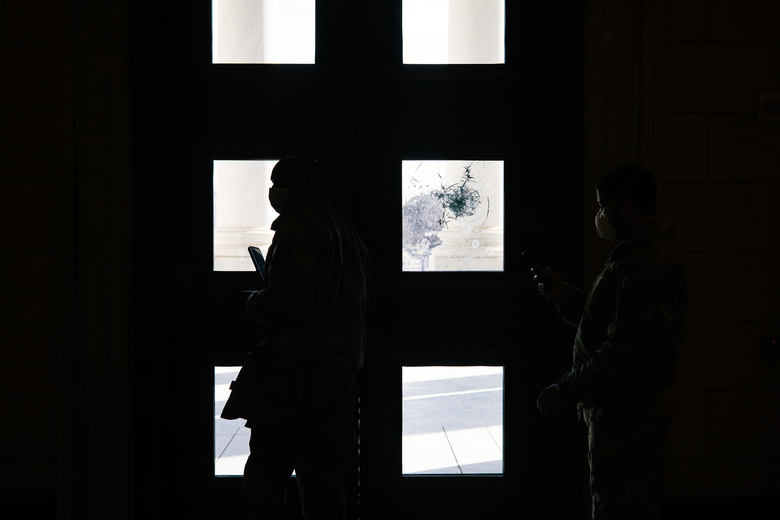 Damage from the mob attack remains visible on the doors of the Capitol in Washington before the start of the impeachment trial of former President Donald Trump on Tuesday, Feb. 9, 2021. As the U.S. Senate opened an unprecedented second impeachment trial of Trump, the powerful video images of last month's deadly assault on the Capitol made abundantly clear how different this proceeding will be from the first. ahead of the impeachment trial.(Alyssa Schukar/The New York Times)