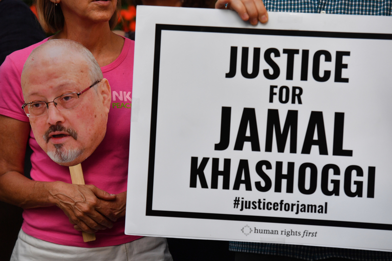 The Committee to Protect Journalists along with other press freedom and human rights groups hold a candlelight vigil in front of the Saudi Embassy in Washington on the first anniversary of journalist Jamal Khashoggi's murder, Oct. 2, 2019. (Washington Post photo by Marvin Joseph).