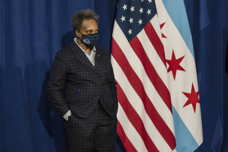 Chicago Mayor Lori Lightfoot listens during a press conference where she demanded the Chicago Teachers Union to reach a deal with Chicago Public Schools on a reopening plan at City Hall, Thursday morning, Feb. 4, 2021, in Chicago. (Pat Nabong/Chicago Sun-Times via AP)