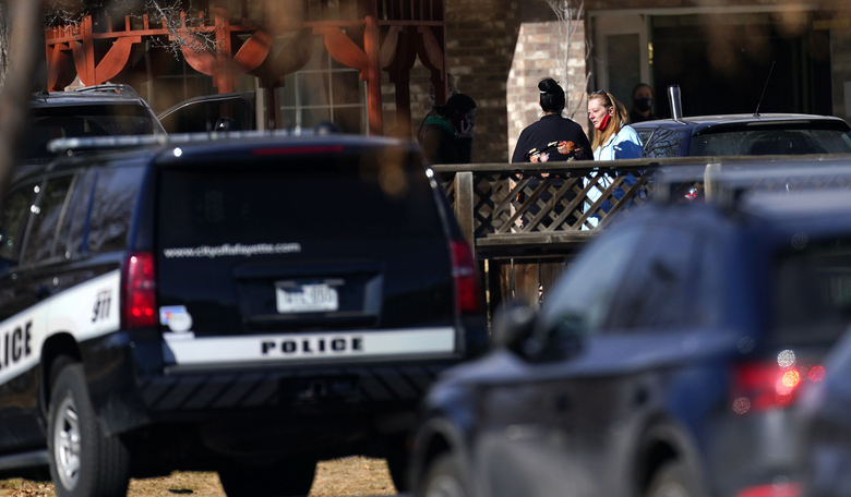 Employees gather outside the Legacy Assisted Living in Lafayette care facility, Wednesday, Feb. 3, 2021, in Lafayette, Colo. A 95-year-old resident of the assisted care home was taken into police custody Wednesday after allegedly shooting an employee at the center. (AP Photo/David Zalubowski)