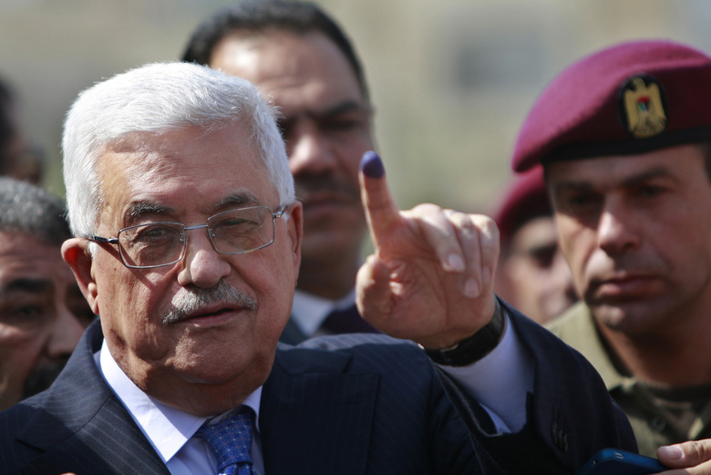 File – In this Saturday, Oct. 20, 2012 file photo, palestinian President Mahmoud Abbas shows his ink-stained finger after casting his vote during local elections at a polling station in the West Bank city of Ramallah. President Abbas called for legislative elections on May 22 and presidential elections on July 31, 2021. (AP Photo/Majdi Mohammed, File)