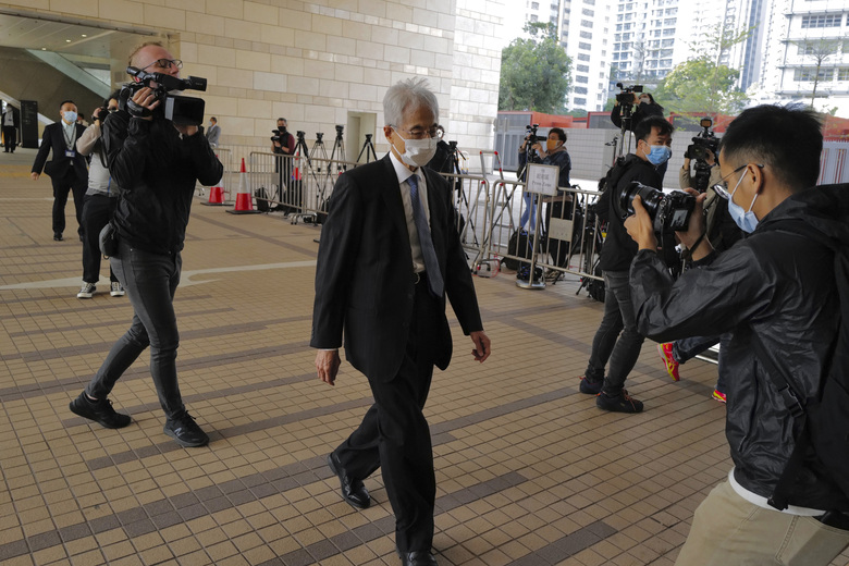 """Pro-democracy lawmaker Martin Lee, center, arrives at a court in Hong Kong Tuesday, Feb. 16, 2021. Nine prominent Hong Kong's democracy advocates faced trial Tuesday on charges of organizing an unauthorized assembly in August 2019. Among the defendants veteran octogenarian lawyer and dubbed Hong Kong's """"father of democracy"""" Lee and media tycoon Jimmy Lai. (AP Photo/Vincent Yu)"""