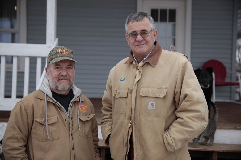 Victor Nemec, left, and Nick Nemec pose outside Nick Nemec's home in Holabird, S.D., Friday, Jan. 29, 2021. Their cousin Joseph Boever was struck and killed by a car driven by the South Dakota Attorney General on Sept. 12. The cousins have been frustrated at the time it has taken for prosecutors to decide whether to charge Ravnsborg. (AP Photo/Stephen Groves)