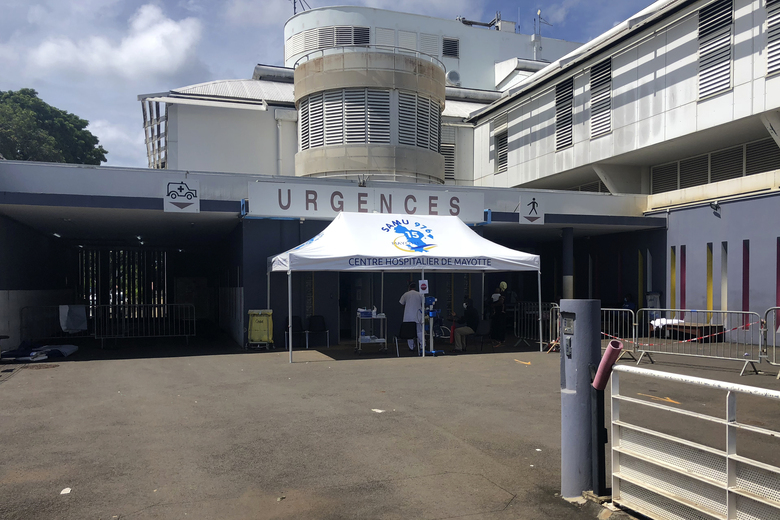 A tent is set up at the entrance of the emergency service of the Mayotte hospital, Sunday Feb.7, 2021. The Mayotte islands are the poorest corner of the European Union, tucked between Madagascar and the mainland coast of Mozambique in southern Africa, and the last spot in the bloc to receive any coronavirus vaccines. Local authorities feel forgotten, and say their difficulties in fighting the virus reflect long-standing inequalities between France's majority-white mainland and its far-flung former colonies where most people are of color. (AP Photo/ Sony Ibrahim Chamsidine)