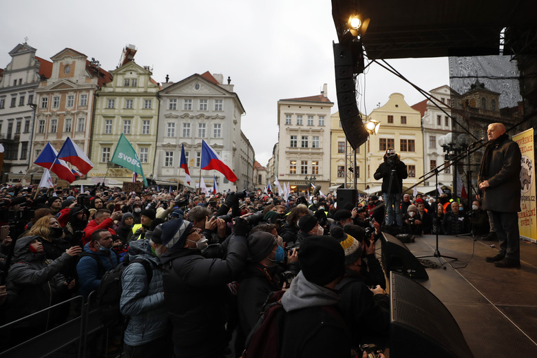 FILE – In this file photo dated Sunday, Jan. 10, 2021, former Czech Republic's President Vaclav Klasu addresses a crowd during a mass demonstration against the government's restrictive measures imposed to contain the coronavirus pandemic, in Prague, Czech Republic.  Reaching a milestone of one million confirmed cases, the battle against the pandemic is far from over in the Czech Republic. Amid warnings by experts against new contagious virus variants, one of the hardest hit European countries has been trying to avoid the mistakes of the past when soaring infections almost caused the collapse of the struggling health system. (AP Photo/Petr David Josek, FILE)