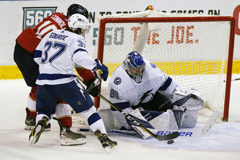 Tampa Bay Lightning goaltender Andrei Vasilevskiy (88) stops a shot on goal by Florida Panthers right wing Brett Connolly (10) as center Yanni Gourde (37) defends, during the third period at an NHL hockey game, Thursday, Feb. 11, 2021, in Sunrise, Fla. (AP Photo/Marta Lavandier)