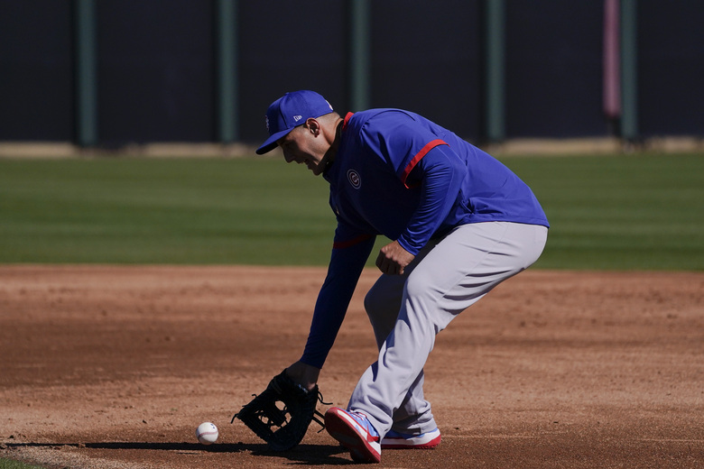Chicago Cubs' Anthony Rizzo fields the ball during the team's spring training baseball workout in Mesa, Ariz., Monday, Feb. 22, 2021. (AP Photo/Jae C. Hong)