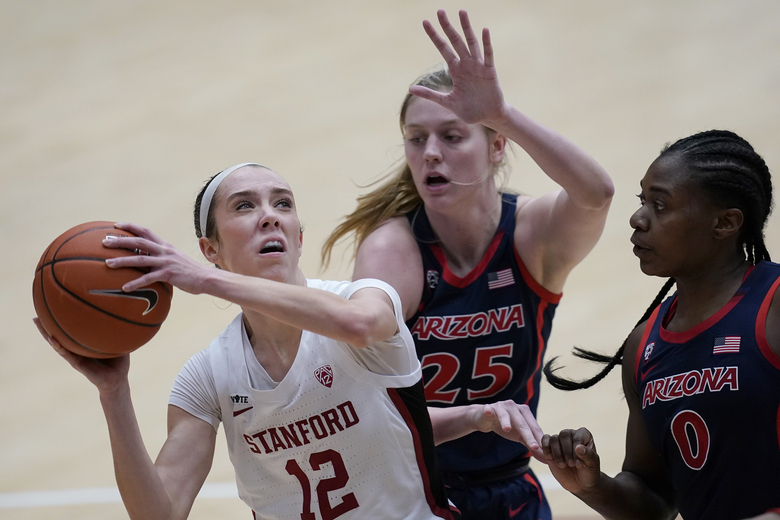 Stanford guard Lexie Hull (12) shoots against Arizona forward Cate Reese (25) and forward Trinity Baptiste (0) during the first half of an NCAA college basketball game in Stanford, Calif., Monday, Feb. 22, 2021. (AP Photo/Jeff Chiu)