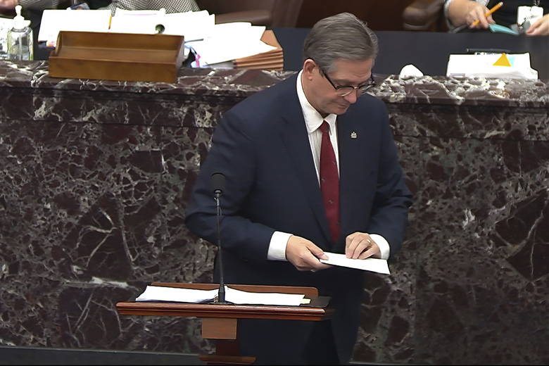 In this image from video, Bruce Castor, an attorney for former President Donald Trump, looks at a piece of paper he was handed as he speaks during the second impeachment trial of Trump in the Senate at the U.S. Capitol in Washington, Friday, Feb. 12, 2021. (Senate Television via AP)