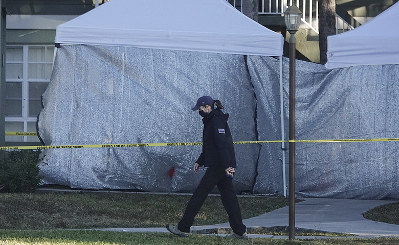 Law enforcement personnel continue to work at an apartment complex the day after a deadly shooting in Sunrise, Fla., Wednesday, Feb. 3, 2021. Several FBI agents were killed and others were wounded while trying to serve a search warrant on a child pornography suspect in Florida. FBI authorities say the suspect also died. (Joe Cavaretta/South Florida Sun-Sentinel via AP)