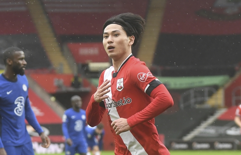Southampton's Takumi Minamino celebrates after scoring his side's opening goal during the English Premier League soccer match between Chelsea and Southampton at St. Mary's Stadium in Southampton, England, Saturday, Feb.20, 2021. (Neil Hall/Pool via AP)