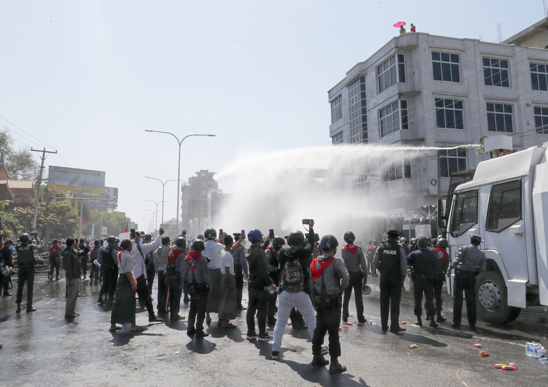 Police use water cannon to disperse demonstrators during a protest in Mandalay, Myanmar, Tuesday, Feb. 9, 2021. Police were cracking down on the demonstrators against Myanmar's military takeover who took to the streets in defiance of new protest bans. (AP Photo)