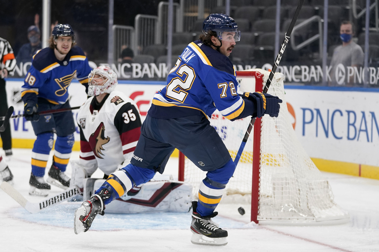 St. Louis Blues' Justin Faulk (72) celebrates after scoring past Arizona Coyotes goaltender Darcy Kuemper (35) as Blues' Robert Thomas (18) watches during the second period of an NHL hockey game Tuesday, Feb. 2, 2021, in St. Louis. (AP Photo/Jeff Roberson)