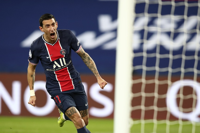PSG's Angel Di Maria celebrates after scoring the opening goal of his team during the French League One soccer match between Paris Saint-Germain and Nimes at the Parc des Princes stadium in Paris, France, Wednesday, Feb. 3, 2021. (AP Photo/Michel Euler)
