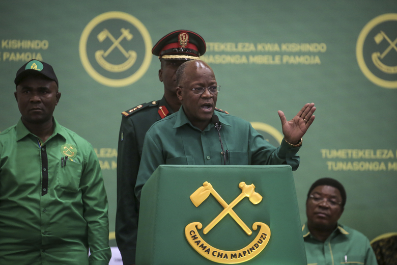 """FILE – In this July 11, 2020, file photo, President John Magufuli speaks at the national congress of his ruling Chama cha Mapinduzi (CCM) party in Dodoma, Tanzania. Tanzania's COVID-denying president Magufuli on Friday Feb. 19, 2021, is calling on citizens for three days of prayer to defeat unnamed """"respiratory diseases"""" amid warnings that the country is seeing a deadly resurgence in infections. (AP Photo, File)"""