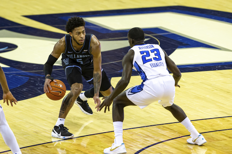 Villanova guard Justin Moore (5) dribbles against Creighton forward Damien Jefferson (23) in the first half during an NCAA college basketball game Saturday, Feb. 13, 2021, in Omaha, Neb. (AP Photo/John Peterson)