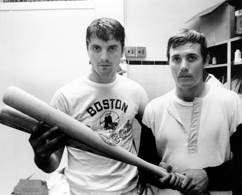 FILE – In this April 16, 1969 file photo, Tony Conigliaro, left, and his brother Billy Conigliaro, both of the Boston Red Sox, are downcast in their dressing room after losing to the Baltimore Orioles 11-8 in the eighth innings at Fenway Park in Boston. Billy Conigliaro, the first-ever Red Sox draft pick who started out in the Boston outfield with star-crossed brother Tony and later spent years taking care of him after a heart attack, died Wednesday, Feb. 10, 2021. He was 73.  (AP Photo/Frank Curtin, File)
