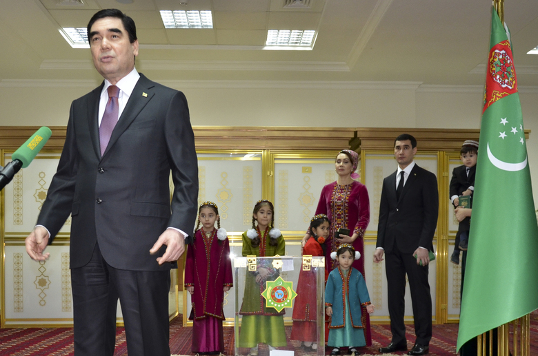 FILE – In this file photo taken on Sunday, Feb. 12, 2017, Turkmenistan President Gurbanguly Berdimuhamedov, left, speaks to journalists after casting his ballot as his son Serdar Berdymukhamedov, second right, with other family members stand behind at a polling station in Ashgabat, Turkmenistan. Turkmenistan's autocratic president has promoted his only son to a deputy prime minister in a move seen as laying the basis for a political dynasty in the energy-rich Central Asian nation. The appointment of President Gurbanguly Berdymukhamedov's son Serdar was announced Friday Feb. 12, 2021, in the government's daily Neutral Turkmenistan. (AP Photo/Alexander Vershinin, File)