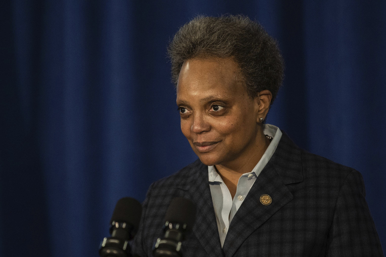 Chicago Mayor Lori Lightfoot clears her throat during a press conference where she demanded the Chicago Teachers Union to reach a deal with Chicago Public Schools on a reopening plan at City Hall on Feb. 4, 2021. The Chicago Teachers Union has approved a deal with the nation's third-largest school district to get students back to class during the coronavirus pandemic, union officials announced early Wednesday, Feb. 10, 2021. (Pat Nabong/Chicago Sun-Times via AP)