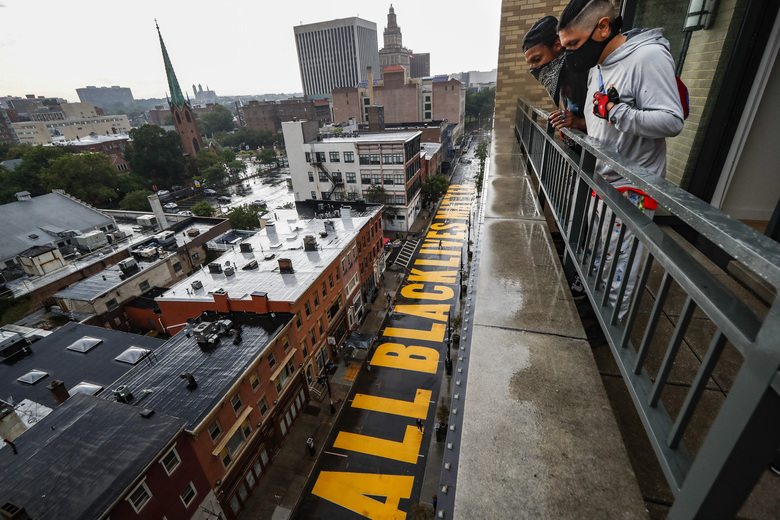 """FILE – In this June 27, 2020, file photo, a mural that reads """"ALL BLACK LIVES MATTER"""" is painted on Halsey Street in Newark, N.J. A financial snapshot shared exclusively with The Associated Press shows the Black Lives Matter Global Network Foundation took in just over $90 million last year. (AP Photo/John Minchillo, File)"""