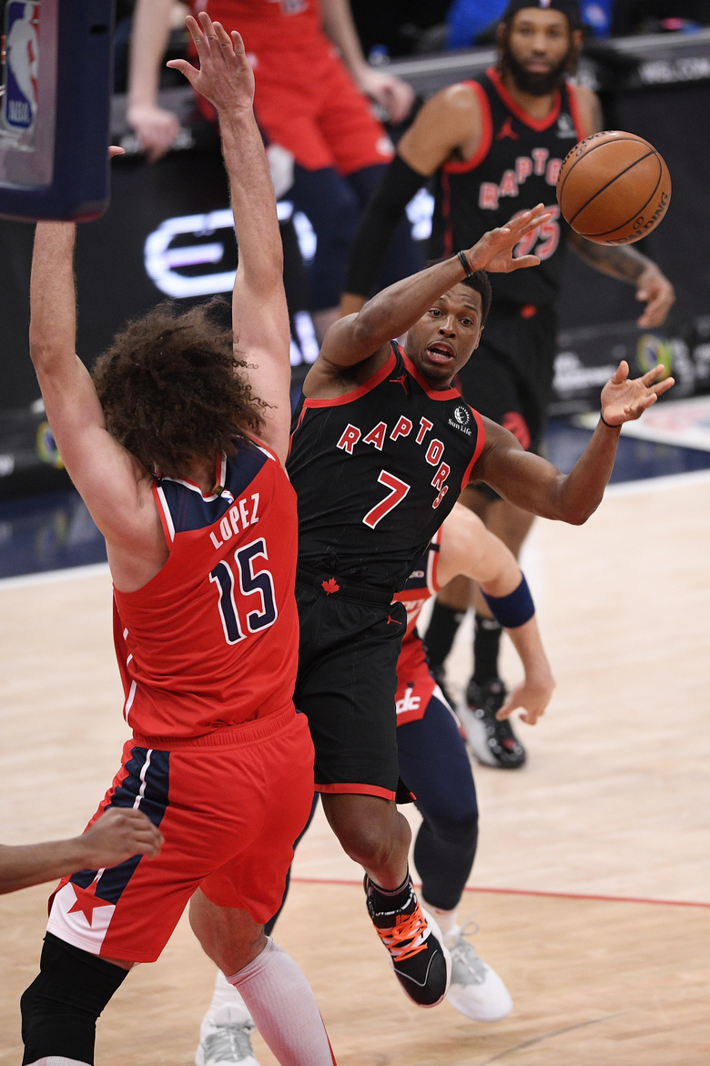 Toronto Raptors guard Kyle Lowry (7) passes against Washington Wizards center Robin Lopez (15) during the second half of an NBA basketball game, Wednesday, Feb. 10, 2021, in Washington. (AP Photo/Nick Wass)