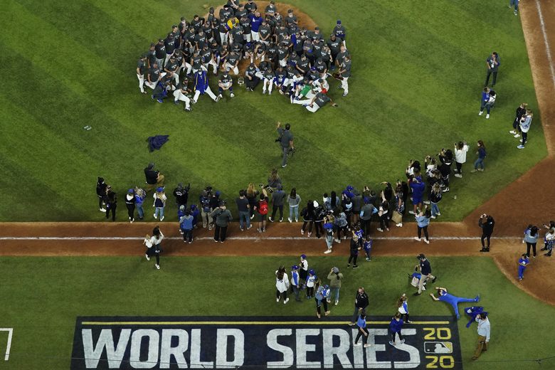 Los Angeles Dodgers pose for a group photo after defeating the Tampa Bay Rays 3-1 to win the baseball World Series in Game 6 Tuesday, Oct. 27, 2020, in Arlington, Texas. (AP Photo/David J. Phillip)