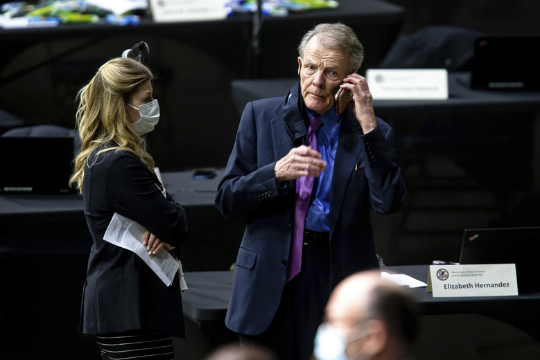 FILE – In this Jan. 13, 2021 file photo, Illinois State Rep. Michael Madigan, D-Chicago, takes a phone call on the floor prior to the swearing in ceremony for the 102nd General Assembly in the Illinois House of Representatives at the Bank of Springfield Center, at the Bank of Springfield Center in Springfield, Ill. Madigan, the Chicago Democrat who virtually set Illinois' political agenda as House speaker before he was ousted last month, resigned his seat Thursday, Feb. 18, 2021. (Justin L. Fowler/The State Journal-Register via AP, File)