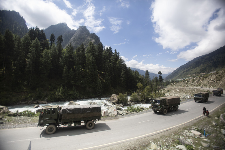 FILE – In this Sept. 1, 2020, file photo, an Indian army convoy moves on the Srinagar- Ladakh highway towards the cold-desert Ladakh region where China and India have been engaged in a tense standoff since May, at Gagangeer, northeast of Srinagar, Indian-controlled Kashmir. India has high hopes its ties with the United States will deepen under President Joe Biden, who was a key proponent of the 2008 civil nuclear deal between the countries and whose new administration includes several Indian Americans. Relations between the world's two largest democracies are driven in part by their desire to maintain strong ties as a counter to China  (AP Photo/Mukhtar Khan, File)