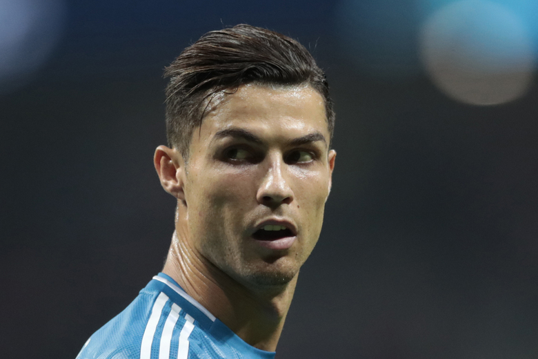 FILE – In this Sept. 18, 2019, file photo, Juventus' Cristiano Ronaldo looks back during the Champions League Group D soccer match in Madrid, Spain. A U.S. appeals court is letting a federal judge in Nevada decide claims by a woman suing soccer star Ronaldo over a $375,000 rape case hush-money settlement reached more than a decade ago. An attorney for Ronaldo declined to comment and a lawyer for Kathryn Mayorga did not respond Monday, Feb. 8, 2021, to messages about a Jan. 13, 2021, order by the 9th U.S. Circuit Court of Appeals. (AP Photo/Bernat Armangue, File)