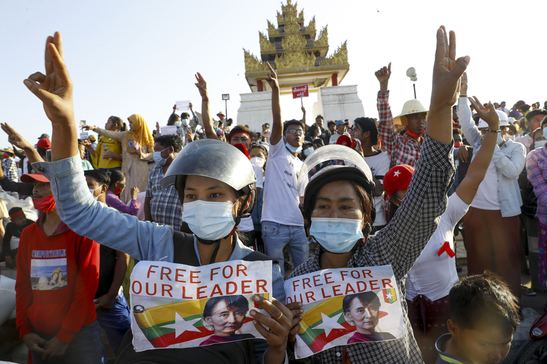 Demonstrators display placards calling for the release of detained Myanmar leader Aung San Suu Kyi and flash three-fingered salutes, a symbol of resistance, against the military coup during a protest in Mandalay, Myanmar, Wednesday, Feb. 10, 2021. Protesters continued to gather Wednesdayin Mandalay breaching Myanmar's new military rulers' decrees that effectively banned peaceful public protests in the country's two biggest cities. (AP Photo)