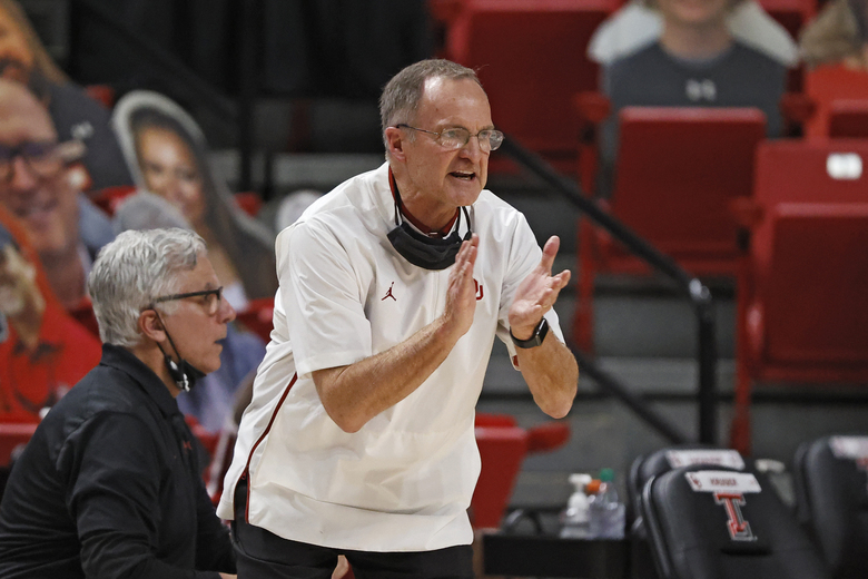 Oklahoma coach Lon Kruger yells to his players during the first half of an NCAA college basketball game against Texas Tech, Monday, Feb. 1, 2021, in Lubbock, Texas. (AP Photo/Brad Tollefson)