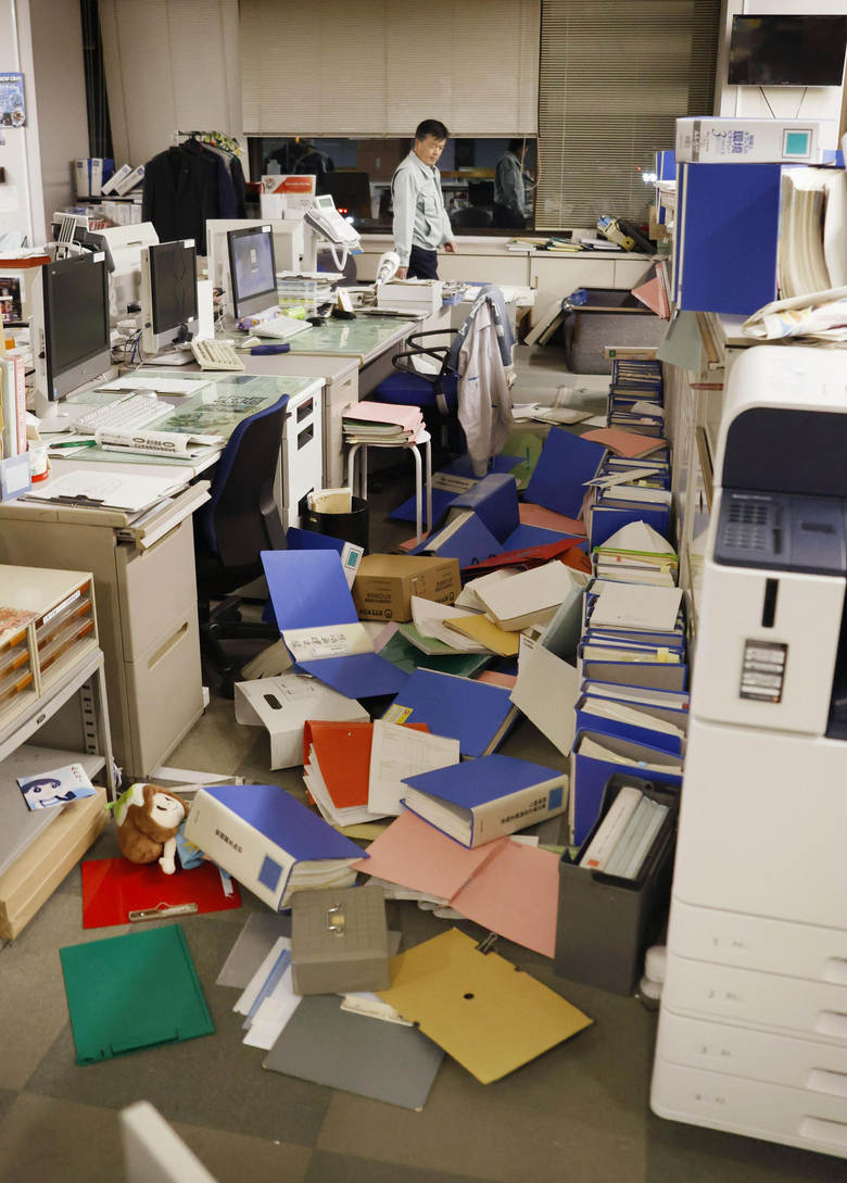 Files are scattered on the floor following an earthquake at a town office in Hironomachi, Fukushima prefecture, northeastern Japan Saturday, Feb. 13, 2021. A strong earthquake hit off the coast of northeastern Japan late Saturday, shaking Fukushima, Miyagi and other areas, but there was no threat of a tsunami, officials said. (Naoya Osato/Kyodo News via AP)
