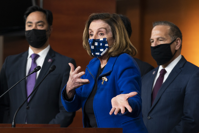 House Speaker Nancy Pelosi of Calif., with impeachment managers Rep. David Cicilline, D-R.I., and Rep. Joaquin Castro, D-Texas, speaks to members of the media during a news conference on Capitol Hill in Washington, after the U.S. Senate voted not guilty, to acquit former President Donald Trump of inciting riot at U.S. Capitol, ending impeachment trial, Saturday, Feb. 13, 2021. (AP Photo/Manuel Balce Ceneta)