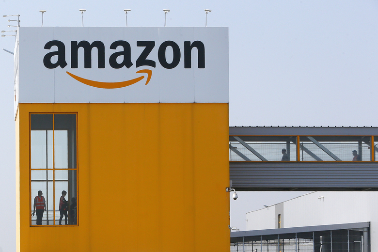 Amazon has become a $1.7 trillion behemoth that sells everything from diapers to sofas, produces movies, owns a grocery chain and provides cloud-computing services to businesses all over the globe. Above, an Amazon facility in northern France on April 9, 2020. (Michel Spingler / The Associated Press)