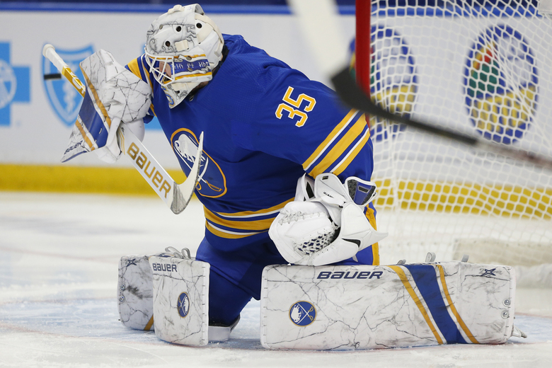 Buffalo Sabres goalie Linus Ullmark (35) makes a save during the first period of an NHL hockey game against the New York Islanders, Monday, Feb. 15, 2021, in Buffalo, N.Y. (AP Photo/Jeffrey T. Barnes)