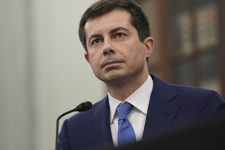 FILE – In this Jan. 21, 2021, file photo, Transportation Secretary nominee Pete Buttigieg speaks during a Senate Commerce, Science and Transportation Committee confirmation hearing on Capitol Hill in Washington. (Stefani Reynolds/Pool via AP)