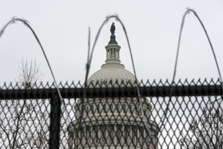 Razor wire tops the anti-scaling fence surrounding the permitter of the U.S. Capitol, Thursday, Feb. 11, 2021, in Washington. (AP Photo/Alex Brandon)