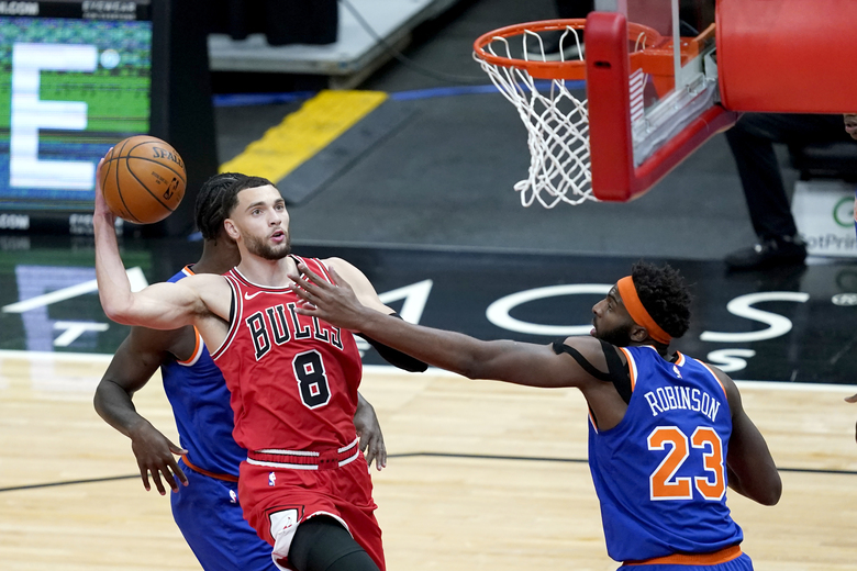 Chicago Bulls' Zach LaVine drives to the basket as New York Knicks' Mitchell Robinson defends during the first half of an NBA basketball game Wednesday, Feb. 3, 2021, in Chicago. (AP Photo/Charles Rex Arbogast)