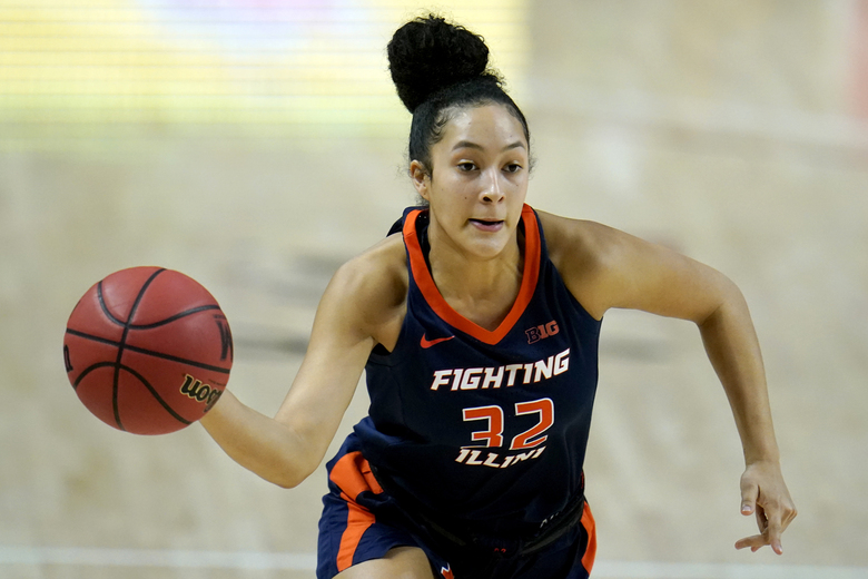 Illinois guard Aaliyah Nye passes the ball to a teammate against Maryland during the first half of an NCAA college basketball game, Wednesday, Feb. 17, 2021, in College Park, Md. (AP Photo/Julio Cortez)