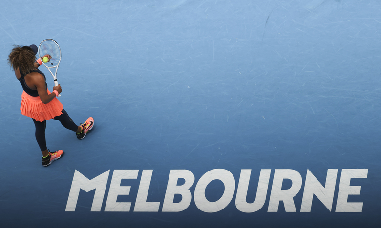 Japan's Naomi Osaka prepares to serve to Spain's Garbine Muguruza during their fourth round match at the Australian Open tennis championship in Melbourne, Australia, Sunday, Feb. 14, 2021.(AP Photo/Hamish Blair)