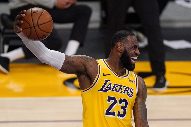 Los Angeles Lakers forward LeBron James jokes around during the overtime period of an NBA basketball game against the Oklahoma City Thunder Monday, Feb. 8, 2021, in Los Angeles. The Lakers won 119-112 in overtime. (AP Photo/Mark J. Terrill)