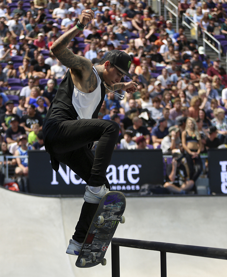 FILE – In this July 22, 2018, file photo, Nyjah Huston, the eventual gold medal winner, pulls off a trick in the men's skateboard street final at the X Games in Minneapolis. Huston is among five people prosecutors in Southern California have charged with organizing parties that were possible super spreader events at the height of the COVID-19 pandemic. (Alex Kormann/Star Tribune via AP, File)